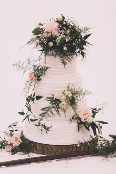 Frosted Wedding Cake with Flower Decor