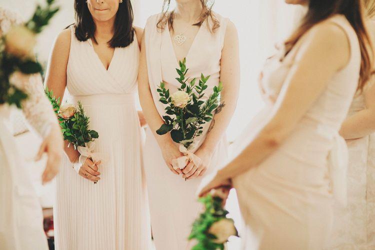 Bridesmaids in Blush Dresses & Single Stem Bouquet