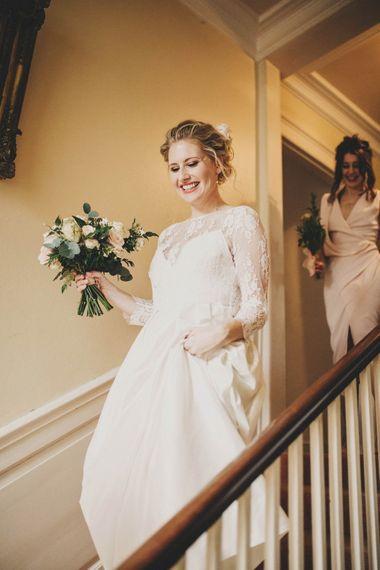 Bride in Rue de Seine Wedding Dress with Long Lace Sleeves
