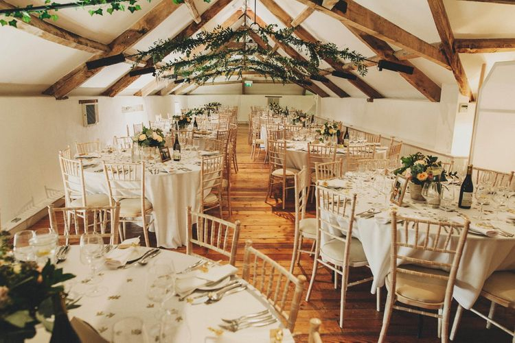Rustic Barn Reception with Greenery Ceiling Decor