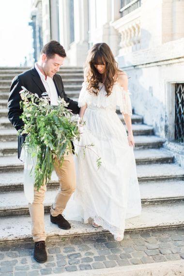 Bride-to-be in Katya Katya Shehurina Dress | Olive Branch Bouquet by Nina E I Fiori | Romantic Engagement Shoot at Villa Borghese Gardens, Rome by The Wedding Stylist | Cecelina Photography