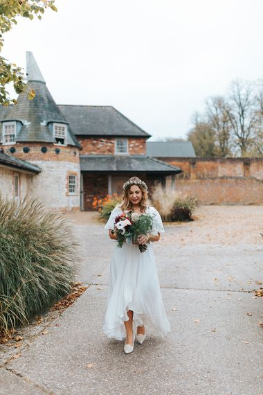 Bride in Boho Minna Bridal 'Rosie' Wedding Dress & Flower Crown