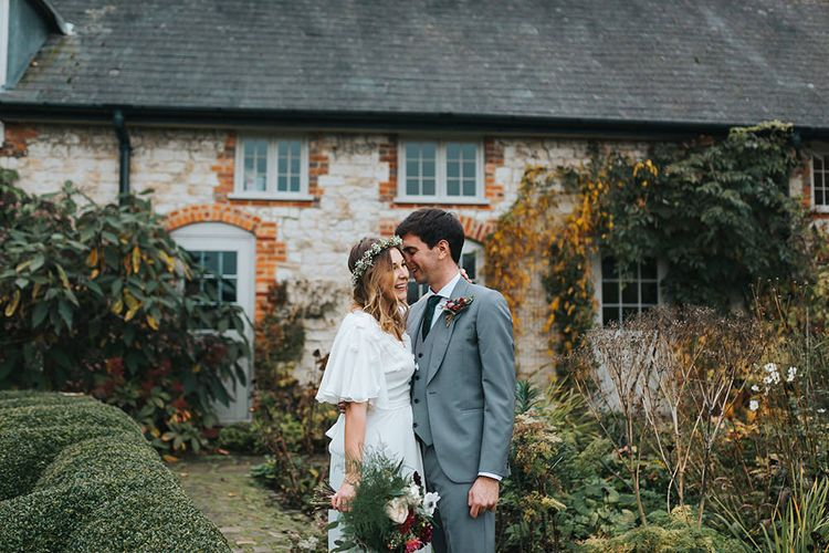 Bride in Boho Minna Bridal 'Rosie' Wedding Dress & Flower Crown and Groom in Paul Smith Suit