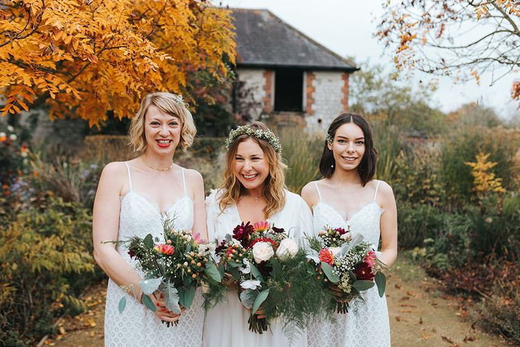 Bridesmaids in White Lace Warehouse Dresses & Autumnal Bouquets