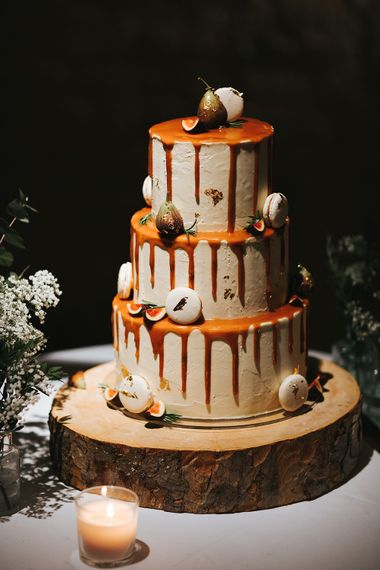 Wedding Cake with Dripping Decor on Tree Slab Cake Stand