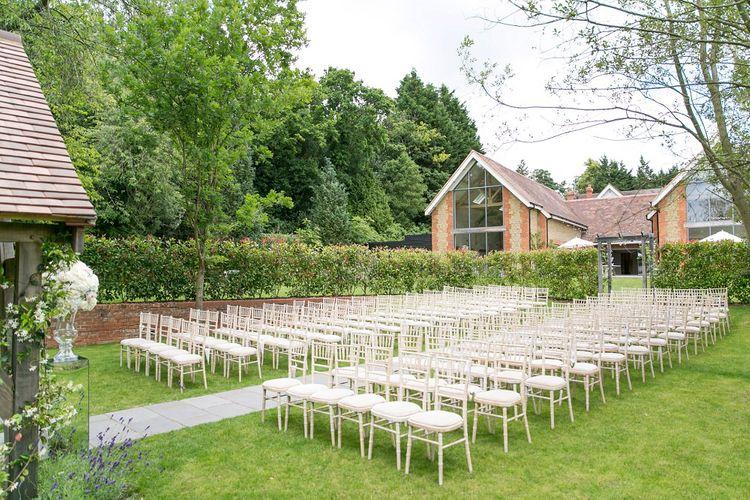 Outdoor Ceremony at Millbridge Court, Surrey | White Hydrangea Flowers | Anneli Marinovich Photography
