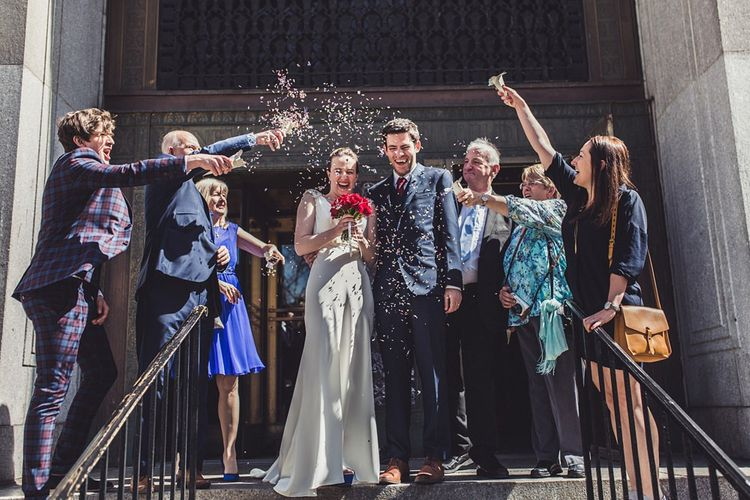 Confetti Moment   Bride in Anoushka G. Gown   Groom in T.M. Lewin Suit   Intimate New York Wedding   Claire Penn Photography