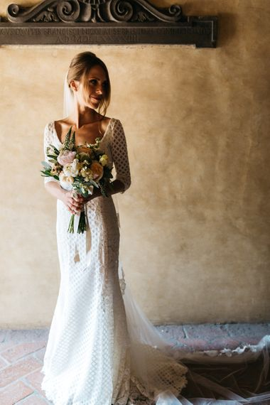 Bride in Luisa Beccaria Bridal Gown with Classic Peach Boutquet