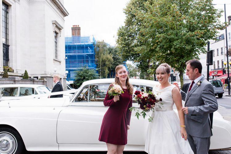 Bride in Bespoke Tea Length Dress | Bridesmaid in Burgundy Dress | 60s Inspired London Pub Wedding | The Peasant | Babb Photo