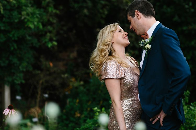 Bride in Gold Sequin Gibson Bespoke Wedding Dress & Groom in Marks and Spencer Suit
