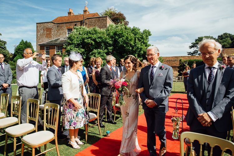 Outdoor Ceremony with Bridal Entrance in Pre Owned Jenny Packham Wedding Dress