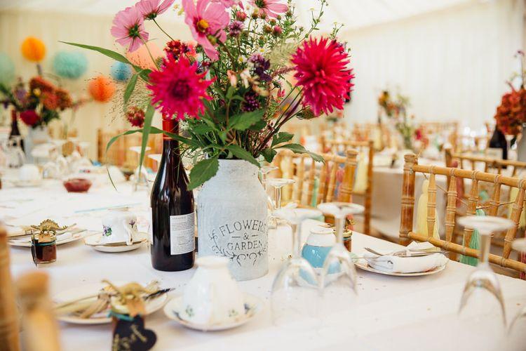 Mason Jars Filled with Wild Flowers Wedding Decor