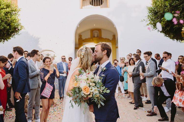Confetti Exit | Bride in Flora Bridal Wedding Dress | Raquel Benito Photography
