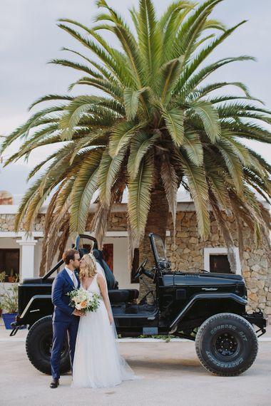 Jeep Wedding Car | Bride in Flora Bridal Wedding Dress | Raquel Benito Photography