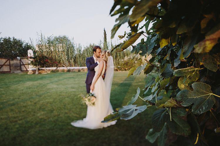 Bride & Groom Portrait | Bride in Flora Bridal Wedding Dress | Raquel Benito Photography