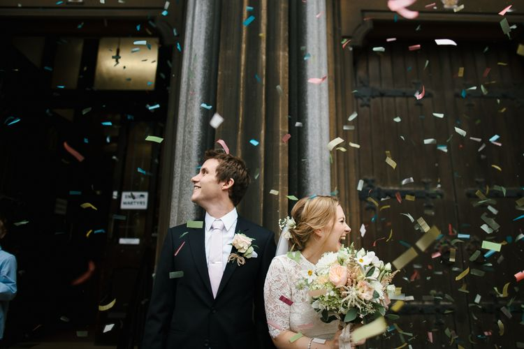 Confetti with Bride in Catherine Deane Separates & Groom in Black Suit