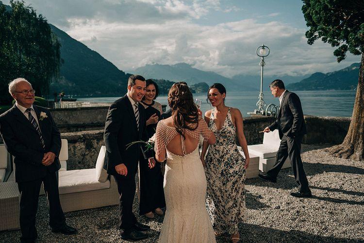 Bride in Lace Fishtail Gown & Beaded Stole | Bellagio Lake Como Wedding Venue | Jason Mark Harris Photography | Harris Films