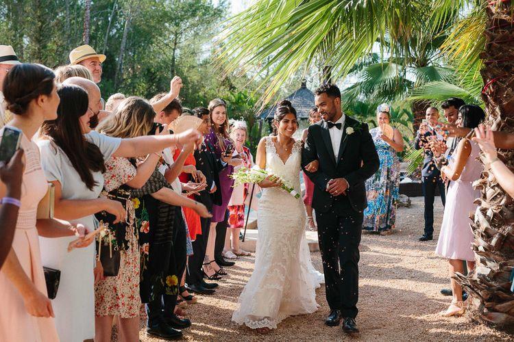Confetti Moment | Bride in Lace Martina Liana Essense Design Wedding Dress | Groom in Paul Smith Suit | Ibiza Destination Wedding | Helen Abraham Photography | Ibiza Wedding Films