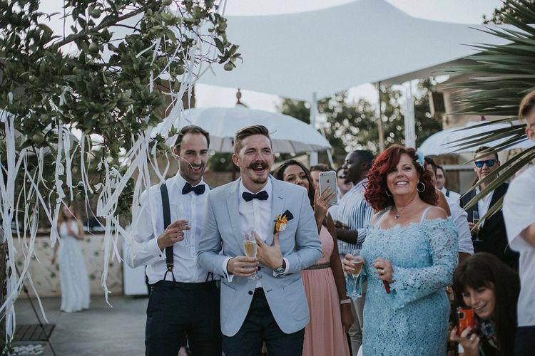 Groom in Pale Blue Blazer & Mrs Bow Tie