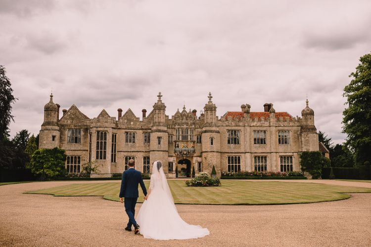 Bride & Groom outside Hengrave Hall Wedding Venue
