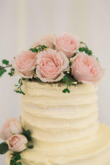 Homemade Elegant Buttercream Wedding Cake with Pink Roses Cake Topper