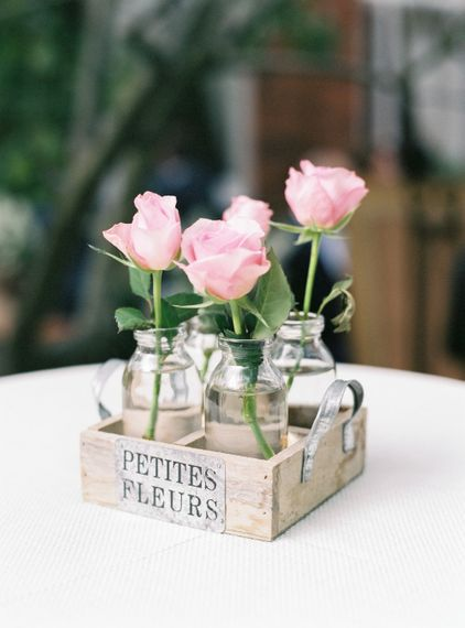 Milk Bottles filled with Pink Flower Stems
