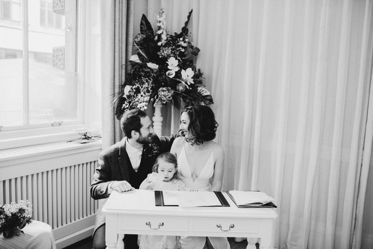 Bride, Groom & Daughter Family Portrait