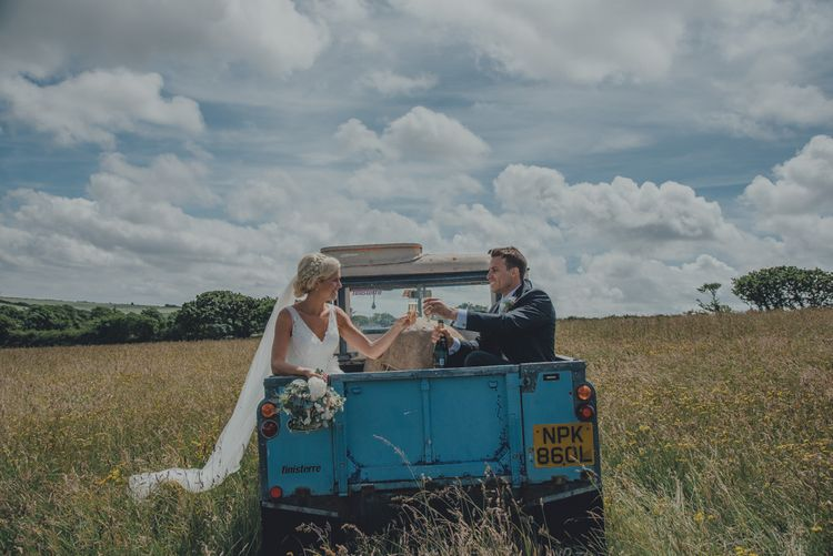 Bride & Groom In Vintage Land Rover