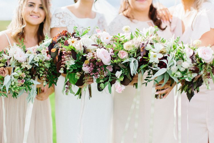 Berry Toned Wedding Bouquets // Personalised Pink Leather Jacket For Bride & Bespoke Luna Bea Crown Marquee Wedding Northumberland Images Melissa Beattie Shoot Me Now Wedding Films