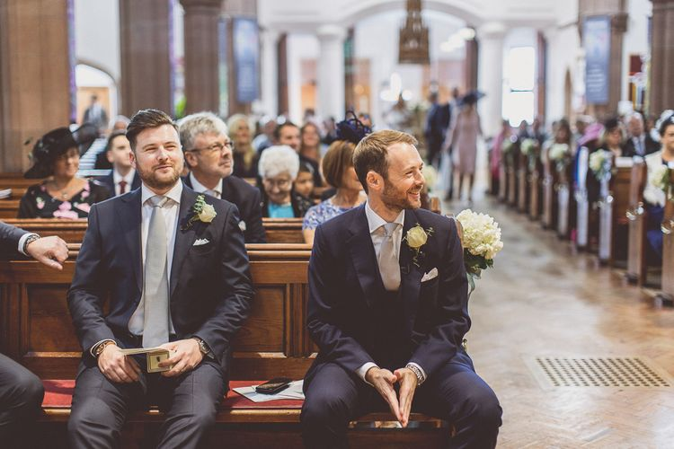 Wedding Ceremony | Groom at the Altar in Navy Whitcomb and Shaftsbury Suit | St. Peters Church in Woolton Village | Classic Wedding at Knowsley Hall Country House in Merseyside | Photography & Film by WE ARE // THE CLARKES