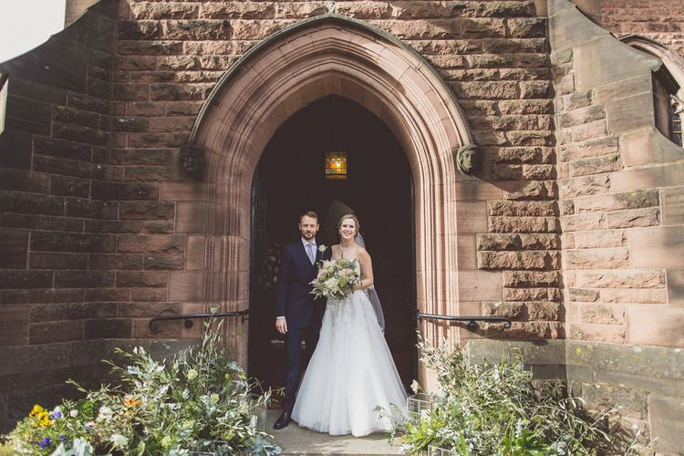 Bride in a Diane Legrand Princess Gown | Groom in Navy Whitcomb and Shaftsbury Suit | St. Peters Church in Woolton Village | Classic Wedding at Knowsley Hall Country House in Merseyside | Photography & Film by WE ARE // THE CLARKES