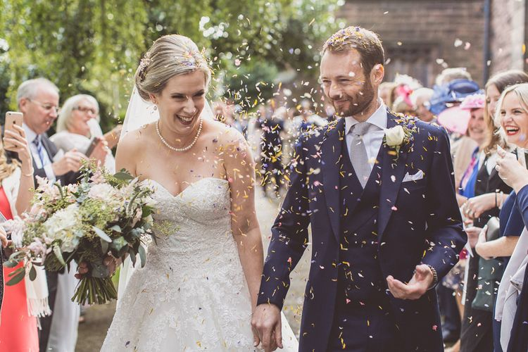 Confetti Exit | Bride in a Diane Legrand Princess Gown | Groom in Navy Whitcomb and Shaftsbury Suit | St. Peters Church in Woolton Village | Classic Wedding at Knowsley Hall Country House in Merseyside | Photography & Film by WE ARE // THE CLARKES
