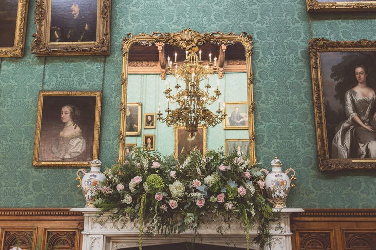 Mantle Piece Flowers | Classic Wedding at Knowsley Hall Country House in Merseyside | Photography & Film by WE ARE // THE CLARKES