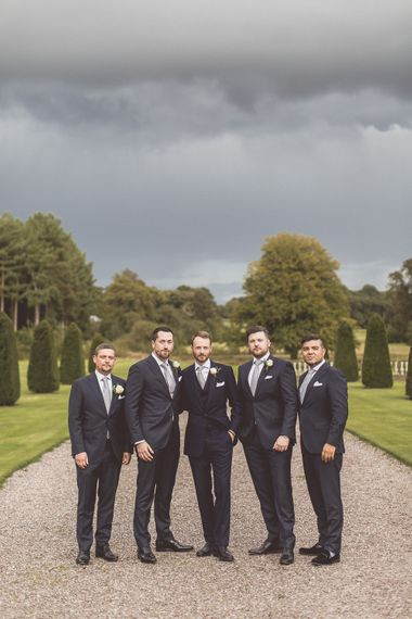 Groom In Navy Whitcomb and Shaftsbury Suit | Groomsmen in Suit Supply | Classic Wedding at Knowsley Hall Country House in Merseyside | Photography & Film by WE ARE // THE CLARKES