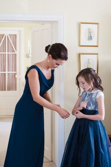 Bridal Preparations   Bridesmaid in Navy   Flower Girl in Navy Dress   Lucy Davenport Photography