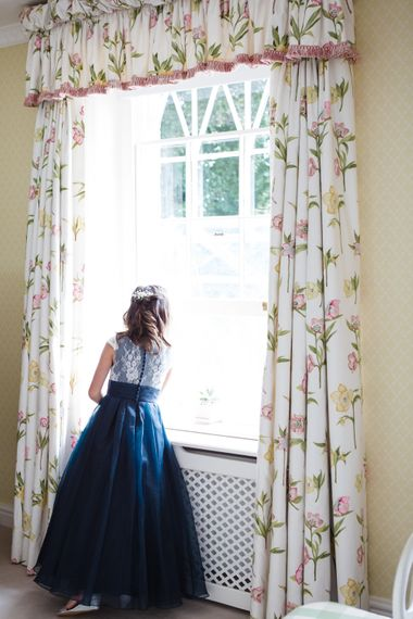Bridal Preparations   Flower Girl in Navy Dress   Lucy Davenport Photography