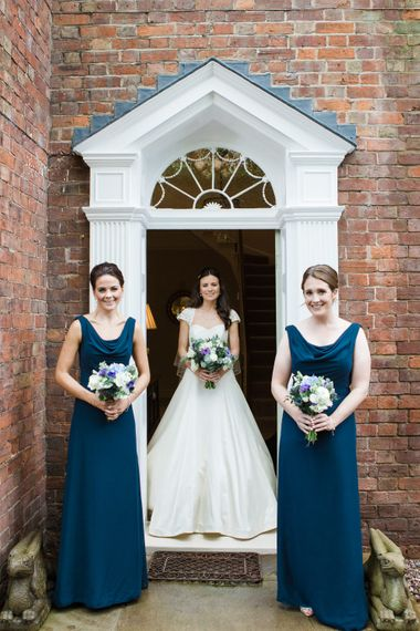 Bridal Party   Classic Bride in Caroline Castigliano Wedding Dress   Bridesmaids in Navy Dresses   Lucy Davenport Photography