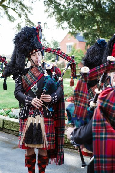 Scottish Bag Pipers in Tartan   Groom in Cad & the Dandy Tails   Lucy Davenport Photography