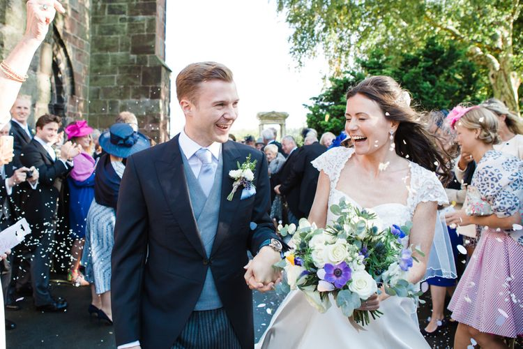 Confetti Moment   Classic Bride in Caroline Castigliano Wedding Dress   Groom in Cad & the Dandy Tails   Lucy Davenport Photography