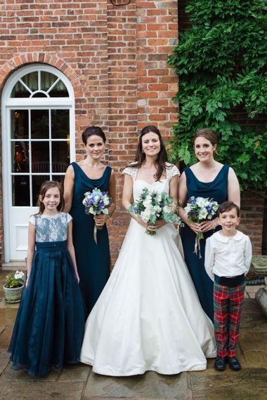 Classic Bride in Caroline Castigliano Wedding Dress   Bridesmaids in Navy Dresses   Lucy Davenport Photography