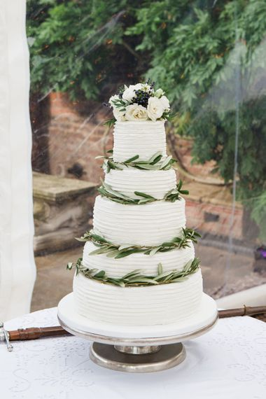 Wedding Cake   Botanical Marquee Reception with Hanging Greenery & Edison Light Installations   Lucy Davenport Photography