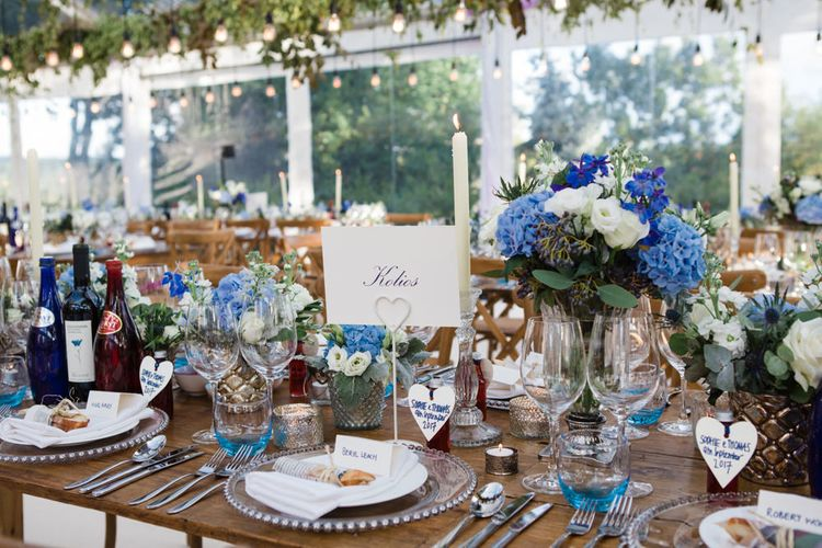 Botanical Marquee Reception with Hanging Greenery & Edison Light Installations   Lucy Davenport Photography