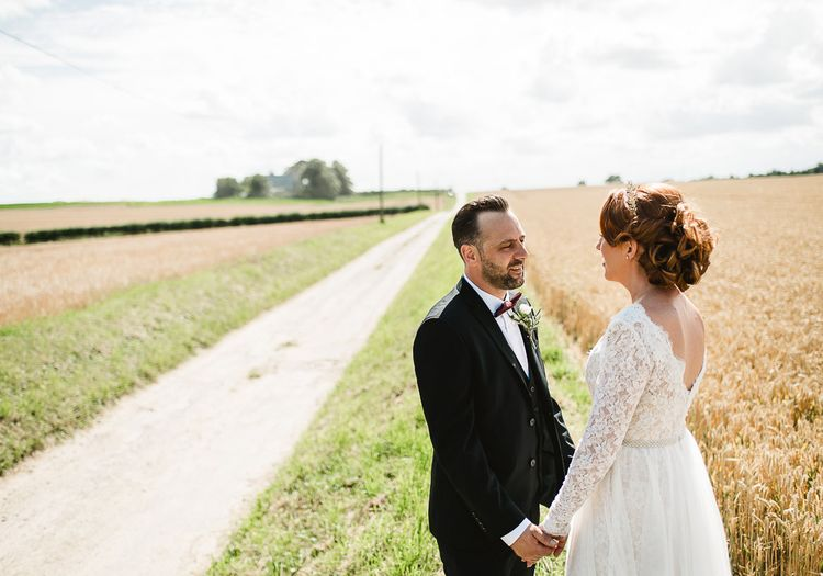 Fishley Hall Wedding With Rustic Details Lots Of Foliage & Festoon Lights With Krispy Kreme Donut Wedding Cake & Images By Luis Holden Photography