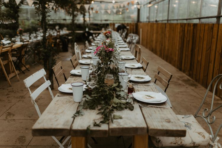Wooden Trestle Tables For Greenhouse Wedding