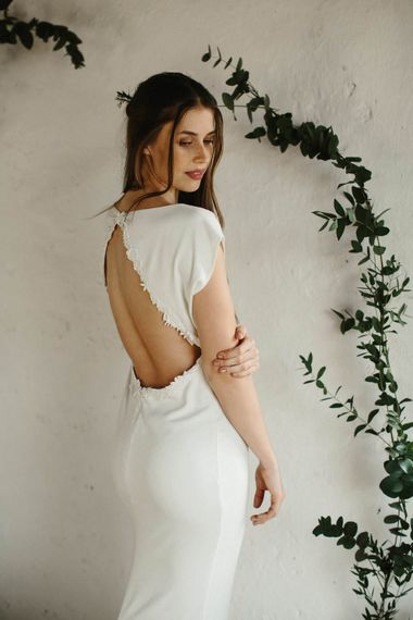 "Backless Bridal Gown | Summer Styling Reimagined | Florals by <ahref=""https://www.loulabelfloraldesign.com"" rel=""noopener"" target=""_blank"">Loulabel</a> 