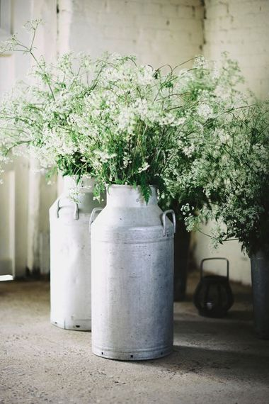 "Cow Parsley Milk Urns | Summer Styling Reimagined | Image by <a href=""https://davidjenkinsphotography.com/ "" rel=""noopener"" target=""_blank"">David Jenkins </a>"