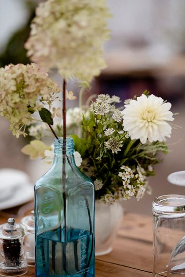 Coloured Glass Vases & Flower Stems Wedding Decor | Eleanor Howarth Photography