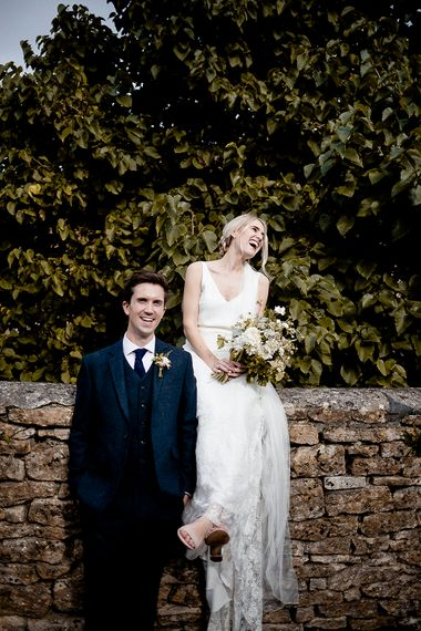 Bride in Charlie Bear Payton Slip & Augustine Over Skirt | Groom in Wool Navy Walker and Slater Suit | Eleanor Howarth Photography