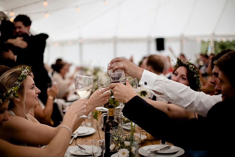 Cheers | Festival Wedding with Bell Tents & Marquee Reception at Stowford Manor Farm | Eleanor Howarth Photography