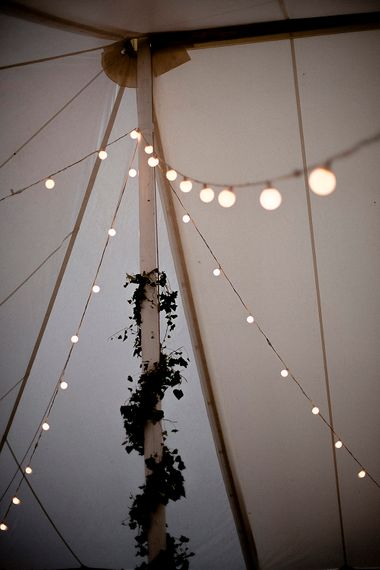 Festoon Lights | Festival Wedding with Bell Tents & Marquee Reception at Stowford Manor Farm | Eleanor Howarth Photography